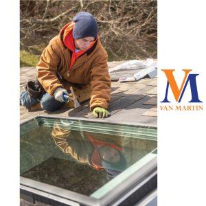 Van Martin crew member installing a Velux skylight