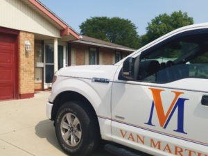 Van Martin Roofing providing a free roof estimate in Trotwood, Ohio.