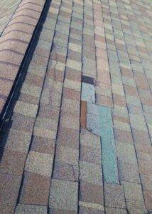 Wind damgaged shingle roof